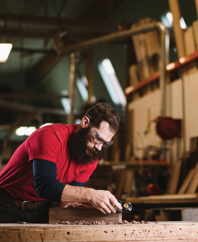 The Joinery handcrafted furniture process. One of our craftsman hand planing some locally sourced Western Walnut