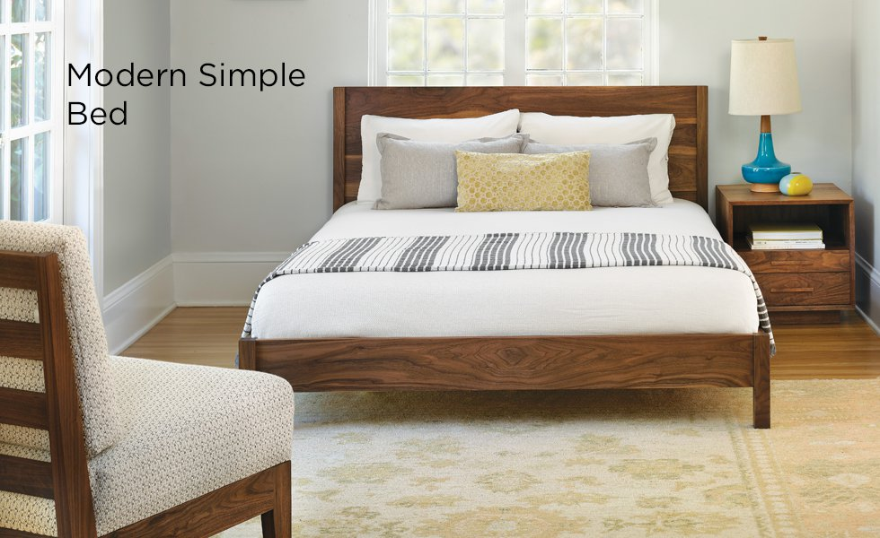Modern Simple bed in Eastern Walnut with Modern Nightstand, Slipper chair, and Caravan Pacific lamp