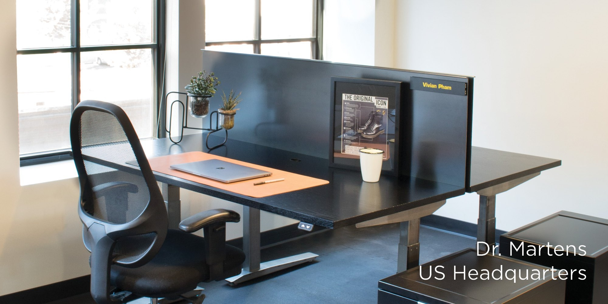 Dr. Martens Sit to Stand Desks with custom privacy panel
