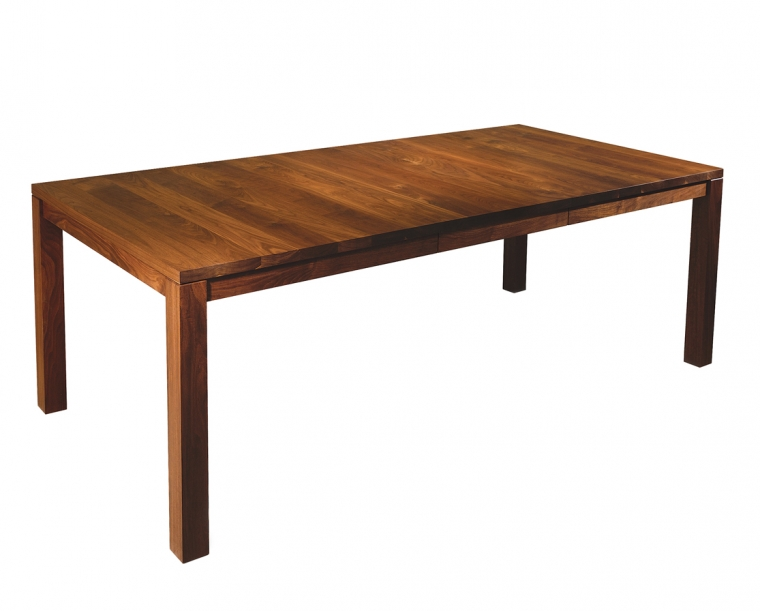 Studio Dining Table in Eastern Walnut, shown with One Leaf