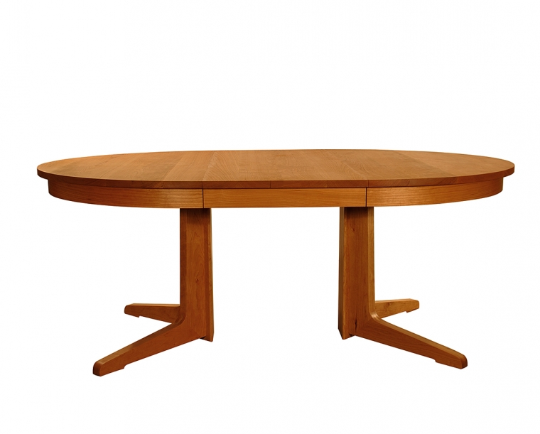 Contemporary Round Pedestal Dining Table in Cherry, shown with one leaf