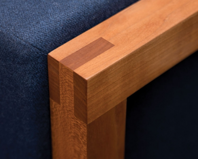 Detail of Celilo Lounge Chair arm in Cherry