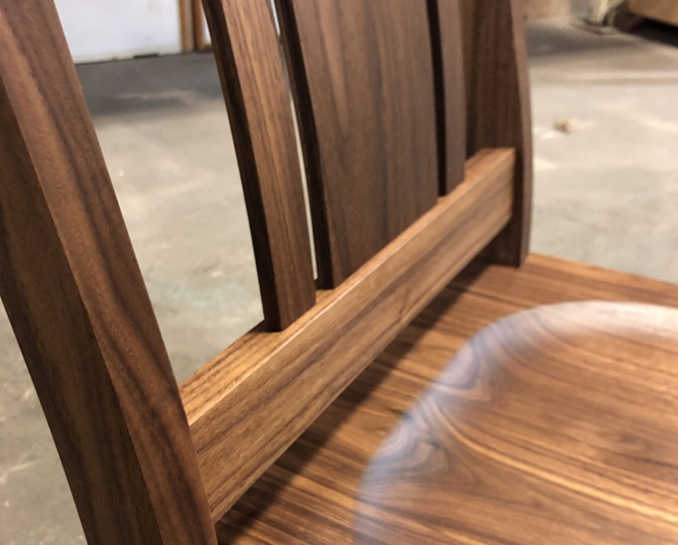 Kenton chair detail in Eastern Walnut with wood seat
