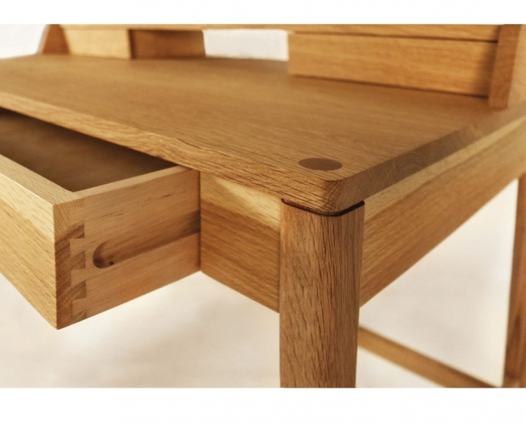 Drawer and desk top thru detail of Maud desk in Oregon White Oak