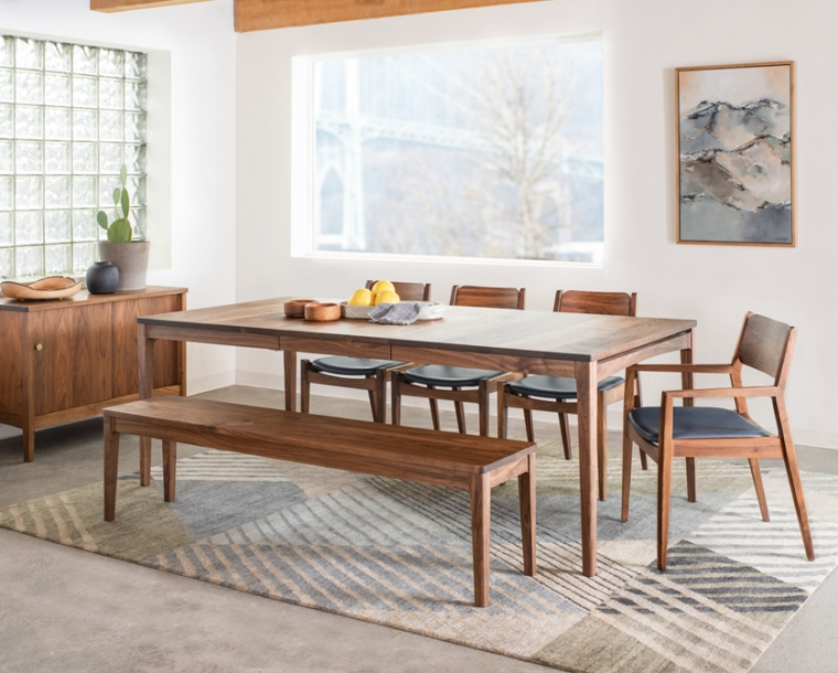 Whitman arm and side chairs with leather upholstery in Eastern Walnut with Whitman dining table, Whitman bench, and Whitman sideboard.