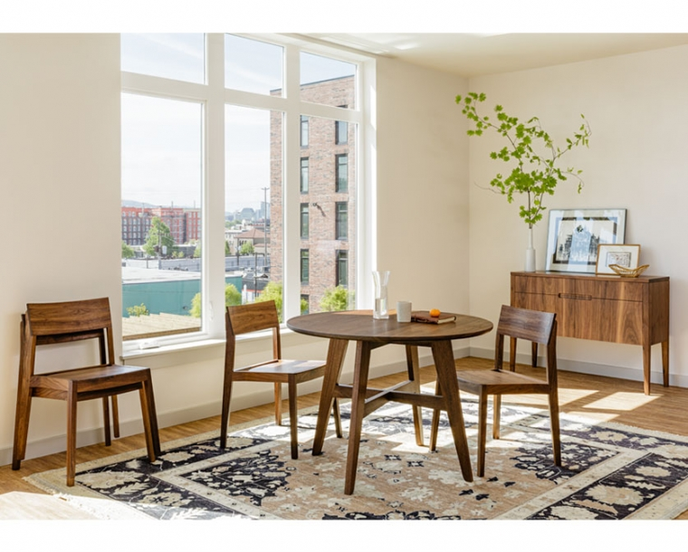 Klamath Dining Table in Eastern Walnut with Klamath chairs and sideboard.
