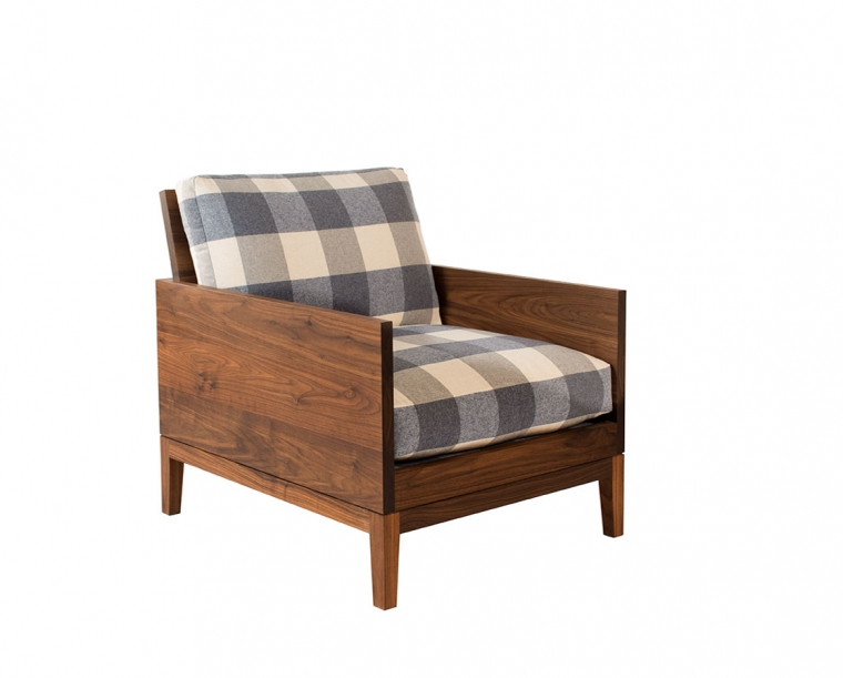Clyde lounge chair in Eastern Walnut with special order fabric.