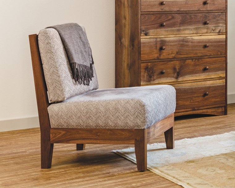 Slipper Lounge chair in Eastern Walnut with COM fabric.