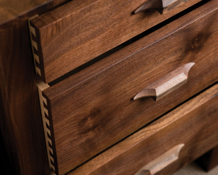 Drawer front detail of Pacific Nightstand in Western Walnut