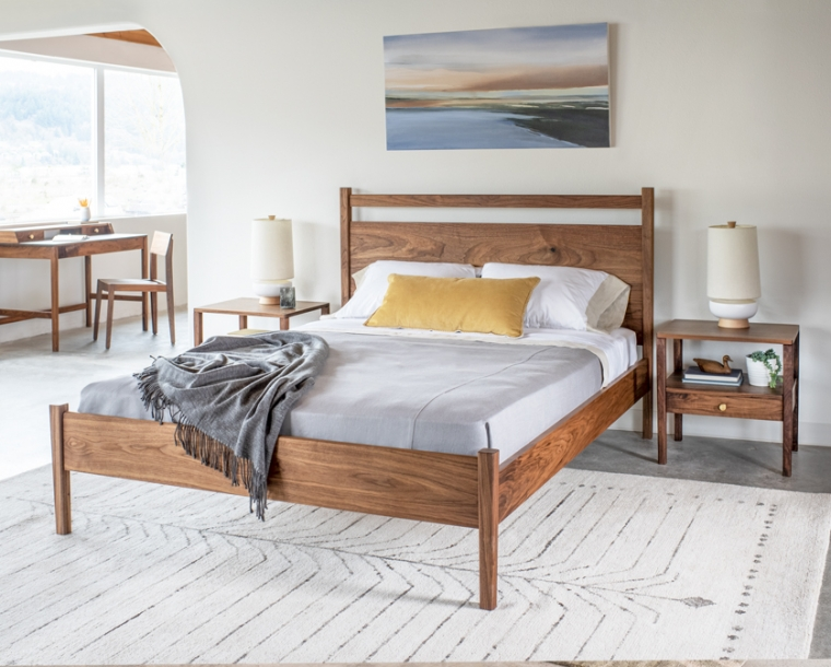 Maud bedroom vignette with Maud nightstands, bed, desk and Klamath Chair in Eastern Walnut